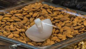 Almonds basket in super market royalty free stock photo