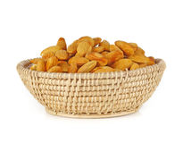 Almonds in basket on white background.  Royalty Free Stock Image