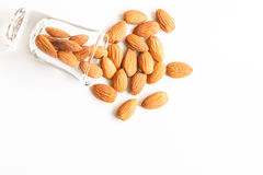 Almonds bean in a glass on white background. Almonds, almonds bean in a glass on white background Royalty Free Stock Image