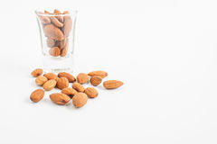 Almonds bean in a glass on white background. Almonds, almonds bean in a glass on white background Royalty Free Stock Photos