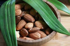 Almonds. Beautiful shot of almonds in wooden bowl royalty free stock images