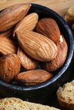 Almonds. Beautiful shot of almonds in wooden bowl royalty free stock photos