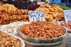 Almonds in big bag and dry friuts on the market Stock Image