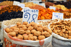 Almonds in big bag and dry friuts on the market Stock Images