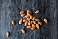 Almonds on black background Royalty Free Stock Image