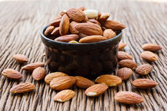 Almonds in black bowl Royalty Free Stock Photos