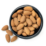 Almonds in Black Bowl Top View Isolated. Almonds in black bowl.  Top view, isolated on white Stock Photos