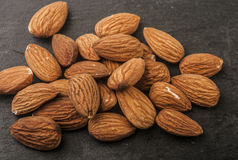 Almonds in a black plate. Stock Photo