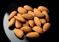 Almonds in a black plate Stock Photo
