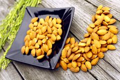 The almonds on a black plate Royalty Free Stock Image