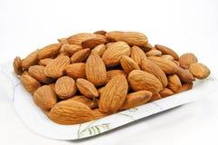 Almonds in a bowl. Almonds are rich in vitamin E Stock Image