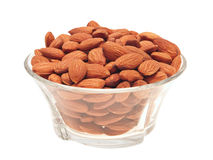 Almonds in bowl. Peeled almonds in a glass bowl. Isolated on white stock photos