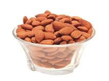 Almonds in bowl. Stock Photos