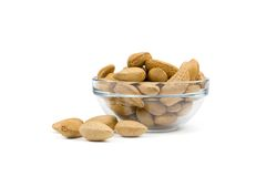 Almonds in a bowl. Almonds in a glass bowl. Isolated on White Stock Image