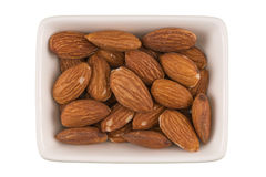 Almonds in a bowl Stock Photography