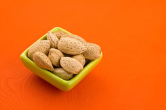 Almonds in a bowl. Stock Photo