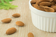 Almonds and bowl of almonds Stock Image