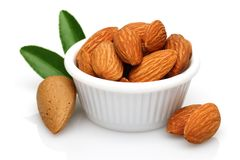 Almonds in the bowl isolated on white. Background stock photography