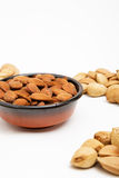 Almonds in a bowl, snacks of nuts. Almonds in shell Stock Photo