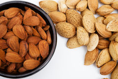 Almonds in a bowl, snacks of nuts. Almonds in shell Royalty Free Stock Image