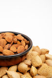 Almonds in a bowl, snacks of nuts. Almonds in shell Royalty Free Stock Photography