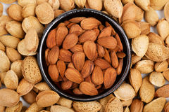 Almonds in a bowl, snacks of nuts Stock Photos
