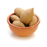 Almonds. In a bowl on white background Stock Images