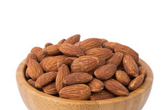 Almonds in the bowl with white background Royalty Free Stock Image
