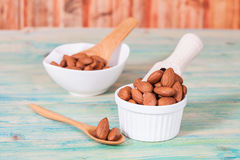 Almonds in bowl Stock Photography