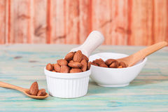 Almonds in bowl Stock Image