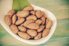 Almonds in bowl on wood Royalty Free Stock Photography