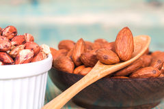 Almonds in  bowl on wooden Royalty Free Stock Photo