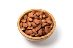 Almonds in brown bowl on white background Royalty Free Stock Photography