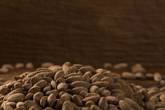 Almonds in brown bowl on wooden background Royalty Free Stock Photos