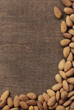Almonds. On brown wooden background Stock Image
