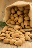 Almonds on brown wooden background Royalty Free Stock Image