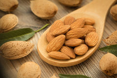 Almonds on brown wooden background Stock Images