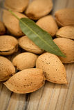 Almonds on brown wooden background Royalty Free Stock Images