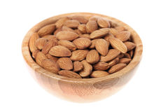 Almonds in a brown wooden bowl Royalty Free Stock Images