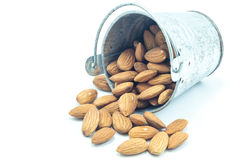 Almonds in bucket  on white background Stock Image