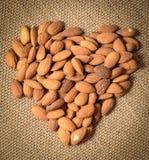 Almonds on a Burlap Background Stock Photos