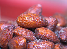 Almonds caramel  in cup on table. Selective focus, Royalty Free Stock Images