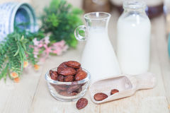 Almonds caramel with milk on table. Selective focus, Stock Photography