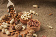 Almonds, cashew and hazelnuts in wooden bowls on wooden and burlap,nuts Stock Photos