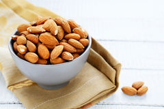 Almonds in a ceramic bowl Royalty Free Stock Photos