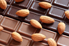 Almonds on chocolate. Close-up Stock Images