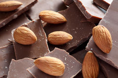 Almonds on chocolate pieces. Close-up Stock Image