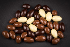 Almonds in chocolate Stock Photos