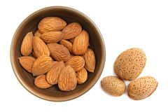Almonds in the clay bowl Royalty Free Stock Photos