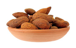 Almonds in clay dish Royalty Free Stock Images